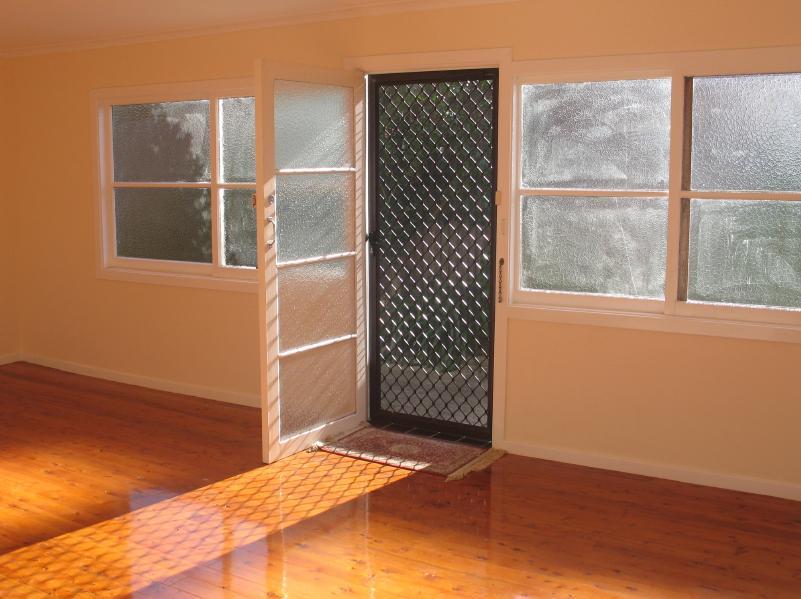 stock-photo-3940502-sunny-doorway-empty-room
